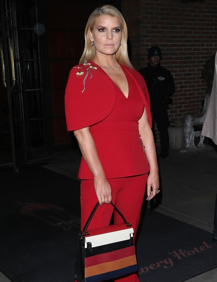 Jessica Simpson's Azalea red sculptured sleeve V-neck top from Safiyaa features a deep V neck, a structured design, a slim fit, a straight hem and a mix of stone embellishments