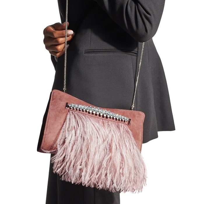 This clutch has a crystal-embellished handle that suspends a row of ostrich feathers, and a smooth satin lining fitted with a slip pocket