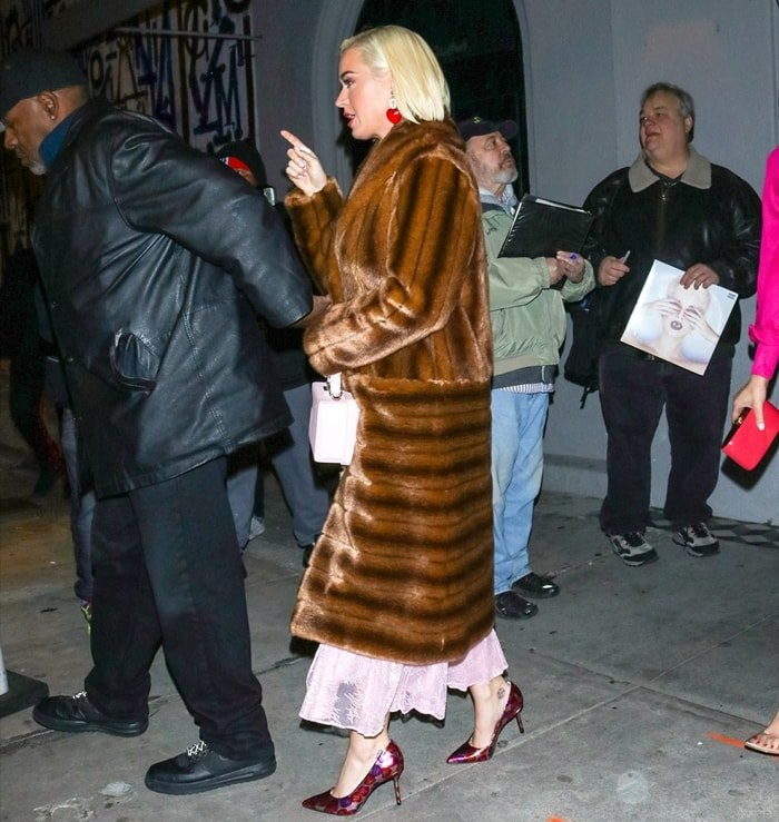 Katy Perry in a coat by MAREI 1998, a fashion house founded and helmed by the young designer Maya Reik