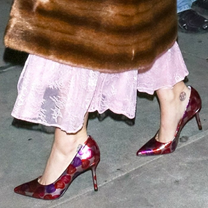 Katy Perry wears pink The Sissy printed pumps with conversation hearts