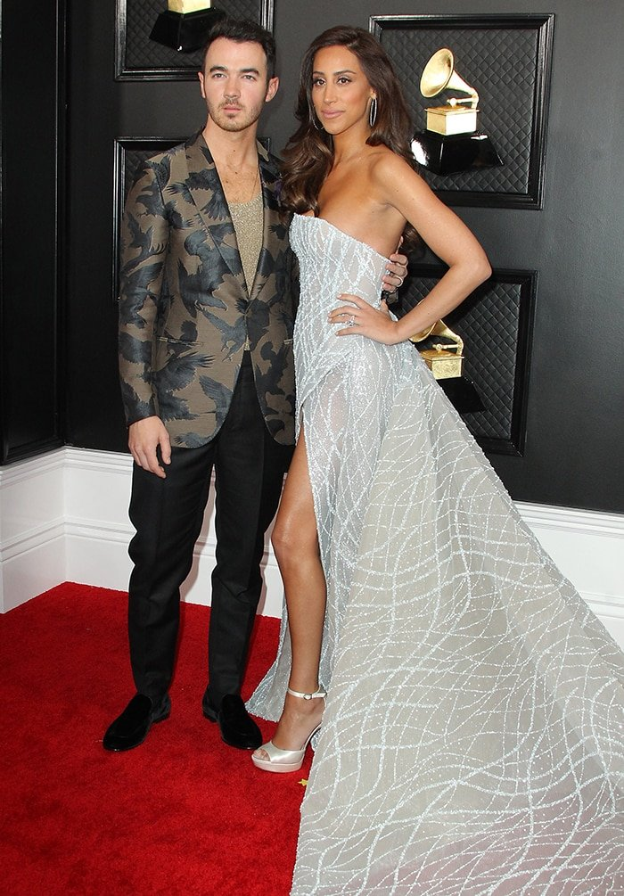 Danielle Jonas channels Disney princess in J'Aton Couture with Kevin Jonas in Ermenegildo Zegna