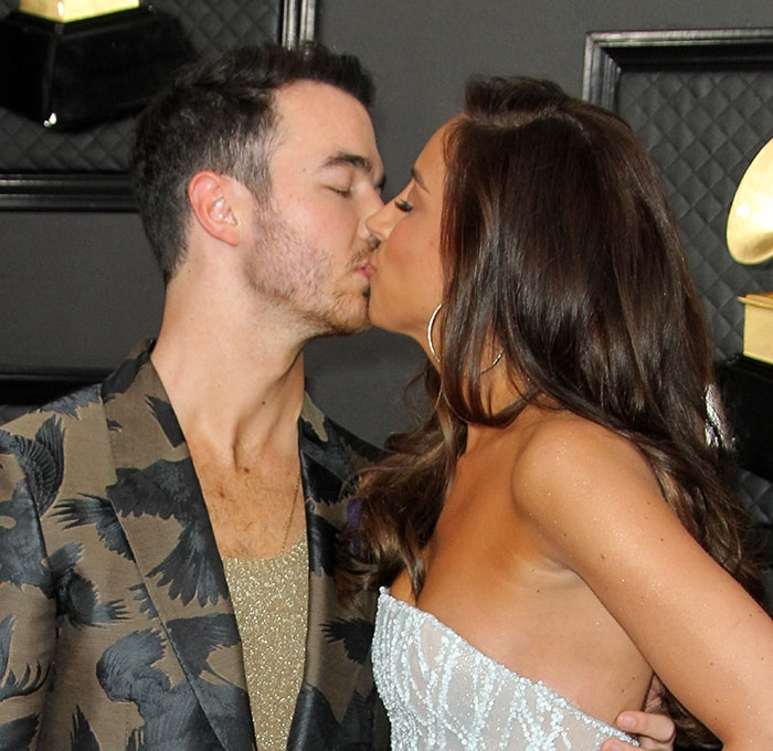 Kevin and Danielle Jonas share a kiss on the Grammy red carpet