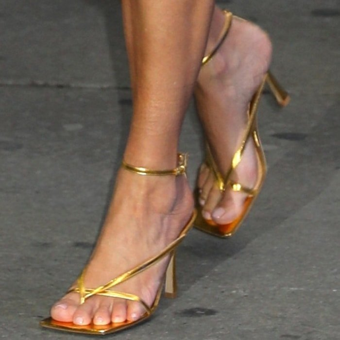 Kim Kardashian's hot feet in Bottega Veneta sandals crafted from glossy golden leather