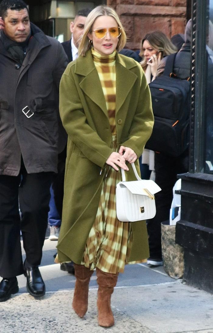 Kristen Bell wearing a Proenza Schouler look with Villa Rouge Baden boots