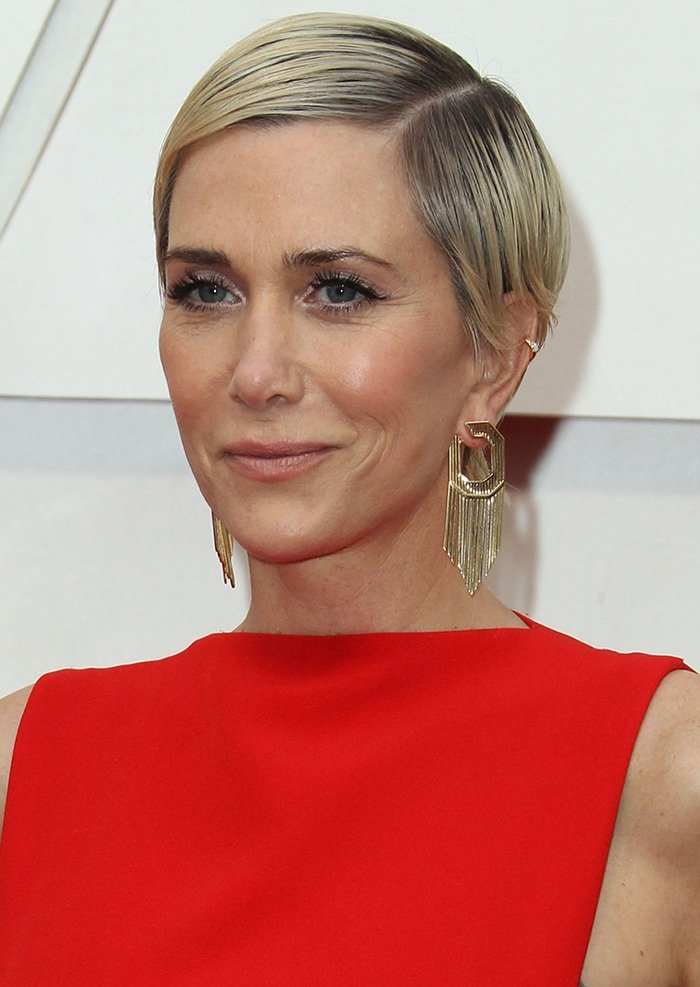 Kristen Wiig in a '60s glam look with side-parted pixie hairstyle