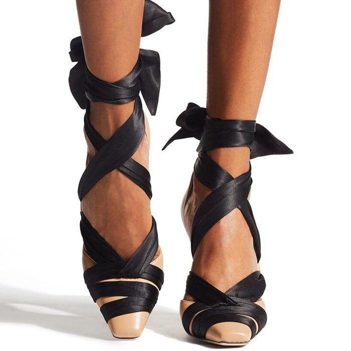 These ballet pumps are trimmed with black satin criss-cross ribbon that wraps around the chic square-toe fronts, before snaking up your ankles, and propped on slender stiletto heels