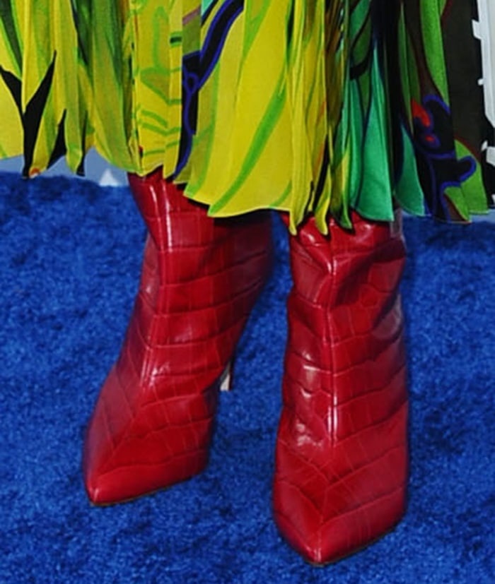 Laura Dern teams her dress with a pair of red boots from Schutz