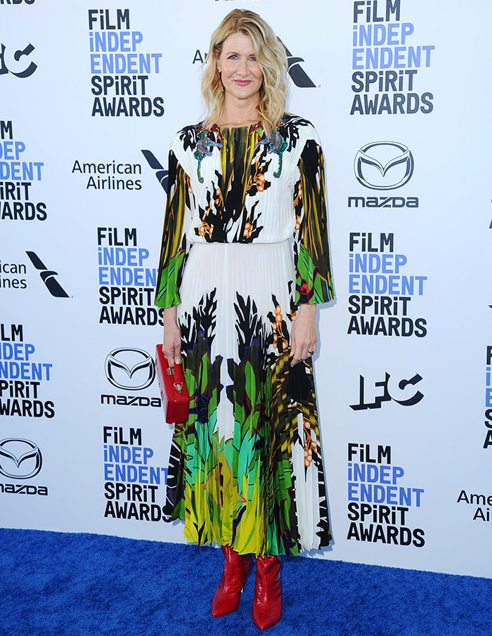 Laura Dern wears a pleated leaf-printed, embellished dress from Valentino