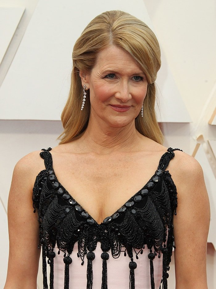 Laura Dern wears her blonde locks in vintage soft curls with soft pink makeup