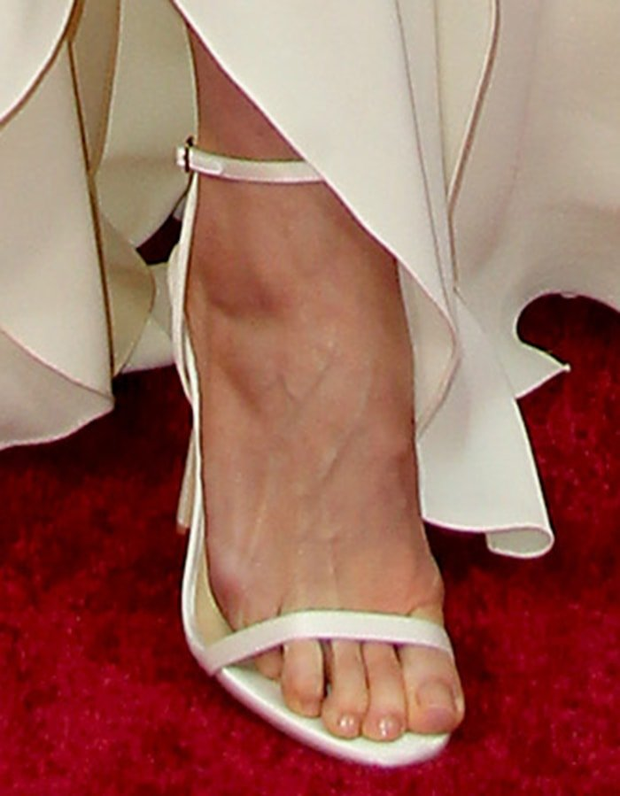Lily Aldridge displays her toes in Jimmy Choo heels