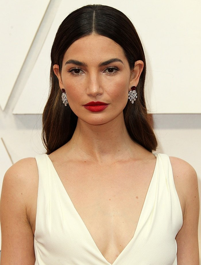 Lily Aldridge looks timeless with red lipstick and center-parted soft curls