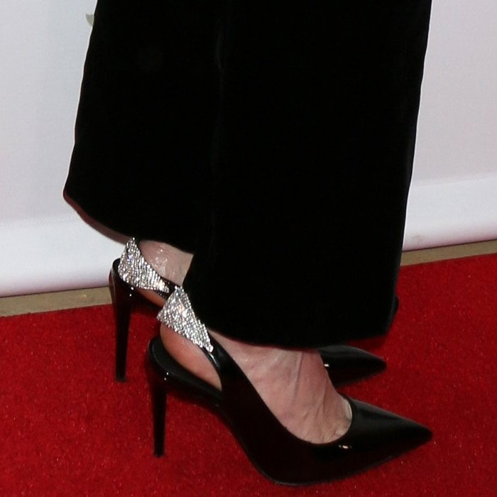 Linda Cardellini's feet in black patent 'Susie' slingback pump with crystal embellishment