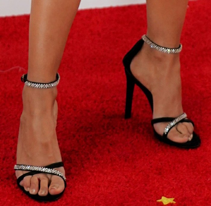 Liza Koshy teams her black-and-white dress with Giuseppe Zanotti embellished sandals
