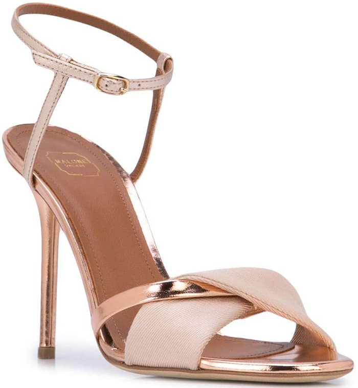 Nude pink and rose gold leather Terry sandals from Malone Souliers by Roy Luwolt featuring an open toe, a high stiletto heel, an ankle strap and a button fastening