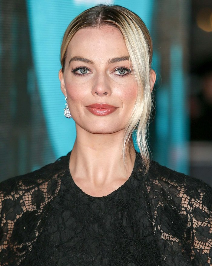 Margot Robbie's kohl-rimmed eyes and swept-back peroxide blonde hair