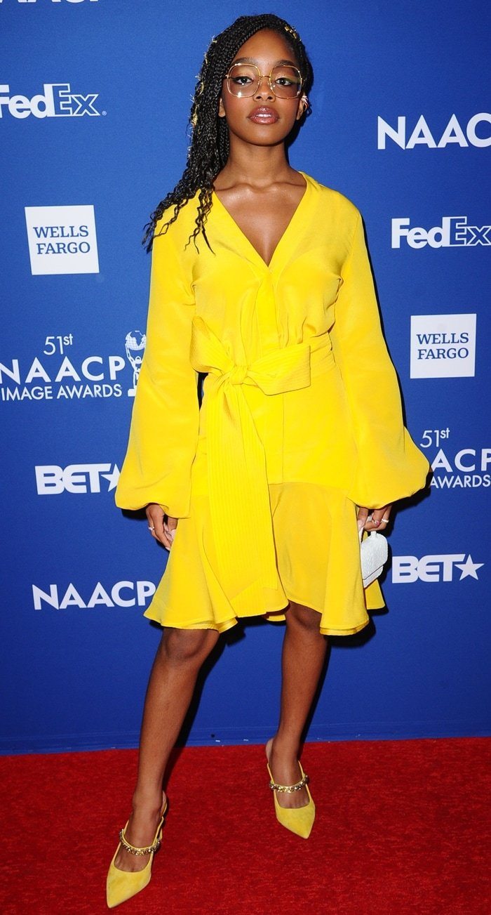 Marsai Martin wears SILVIA TCHERASSI's marigold Filis belted silk crepe de chine mini dress