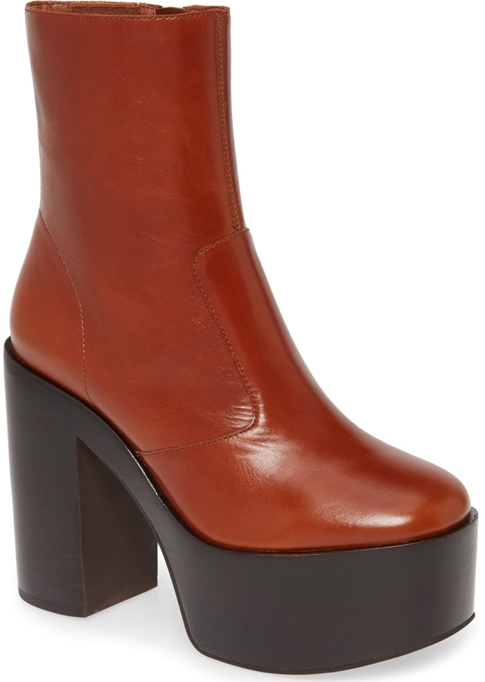 Step out in bold retro style with this streamlined bootie set on a lofty platform sole