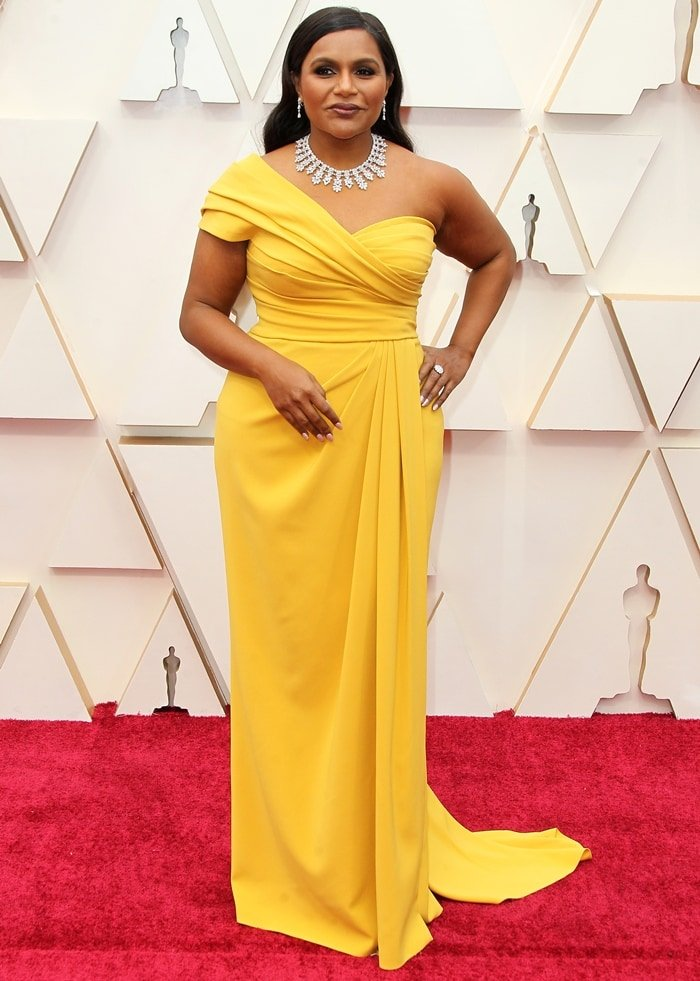 Mindy Kaling brightened up the red carpet in Dolce & Gabbana while arriving at the 2020 Academy Awards