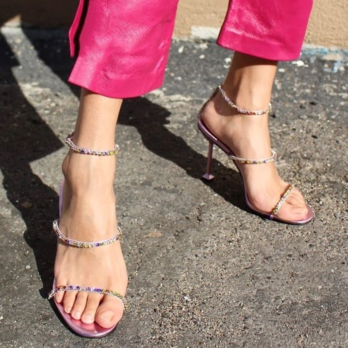 Itty-bitty straps iced in crystals top this devilishly fierce Demonic sandal distinguished by its slender cylindrical heel with a square base