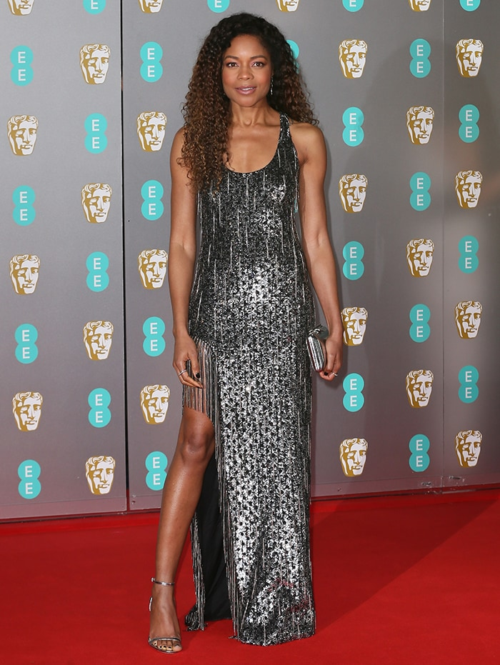Naomie Harris displays her toned figure in metallic Michael Kors gown