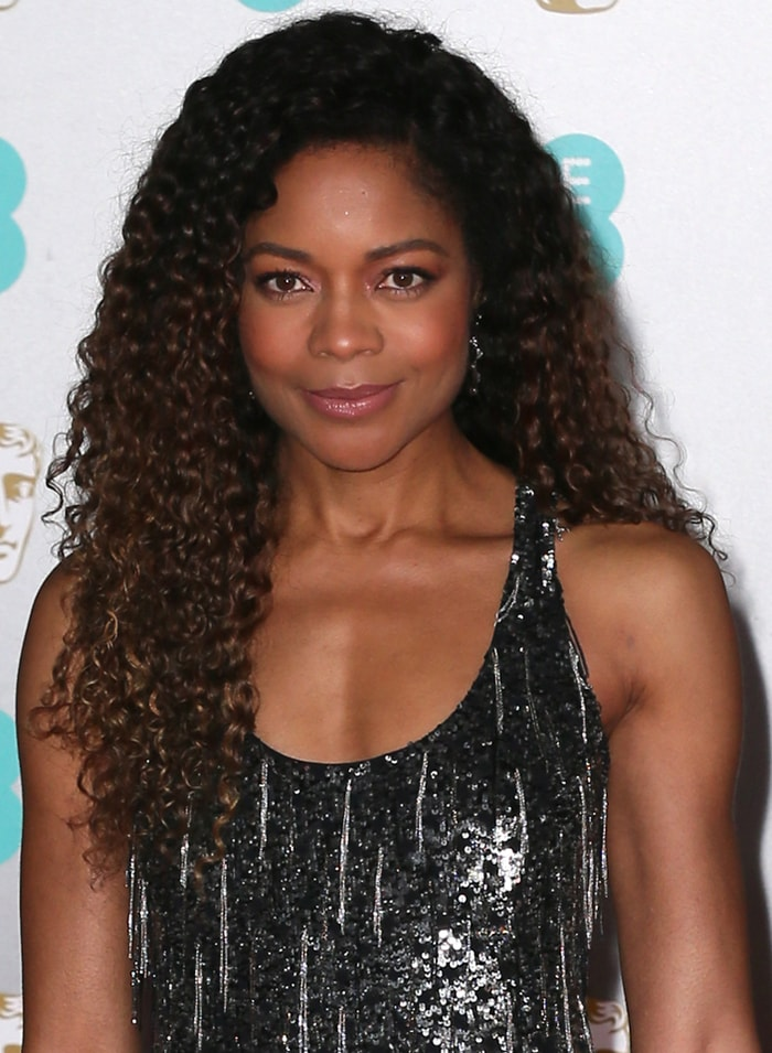 Naomie Harris wears her hair in voluminous curls