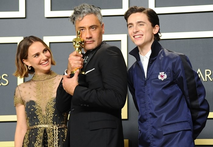 Natalie Portman, Taika Waititi, winner of the Adapted Screenplay award for Jojo Rabbit and Timothée Chalamet