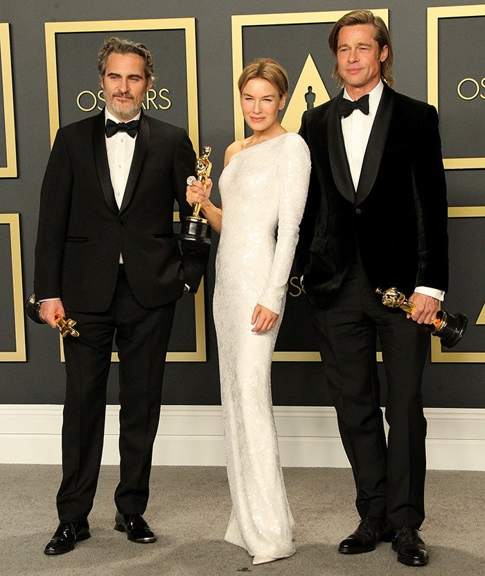 Academy Awards winners Joaquin Phoenix, Renee Zellweger, and Brad Pitt pose together with their Oscar trophies