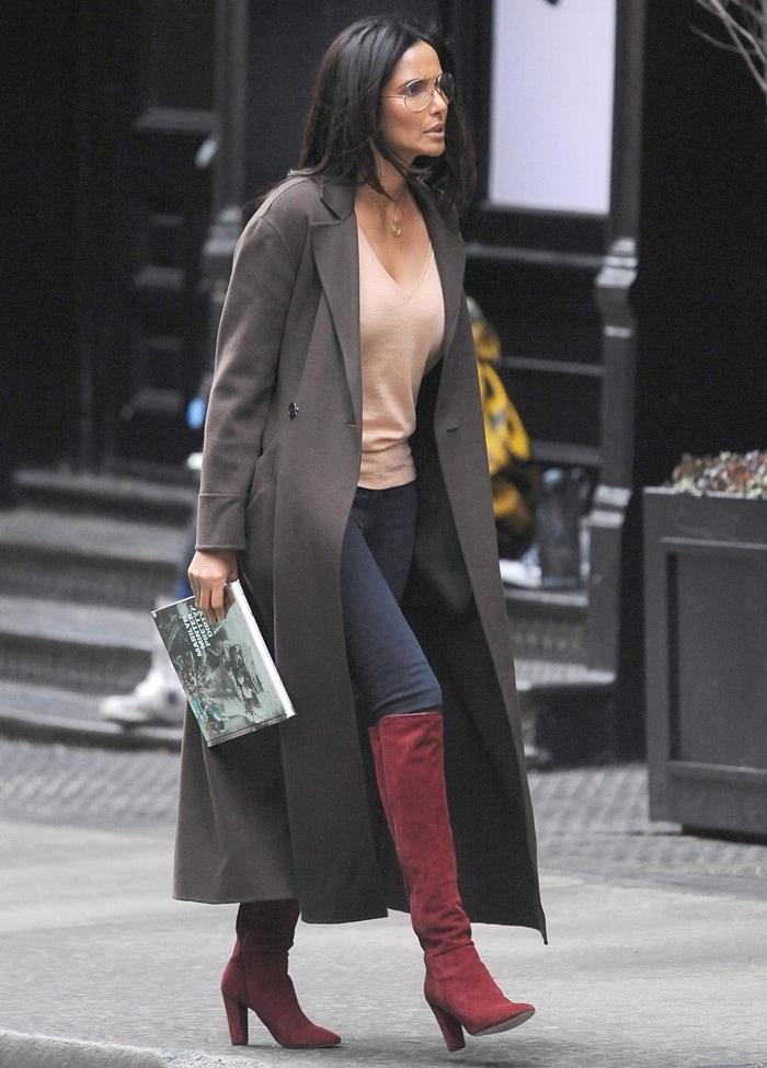 Padma Lakshmi carrying Marilyn Minter's photo art book Pretty/Dirty