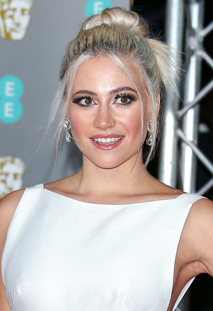 Pixie Lott highlights her eyes with false lashes and eyeliner and wears a swept-back updo