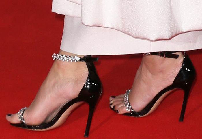 Pixie Lott shows off her black pedicure in crystal-embellished black sandals