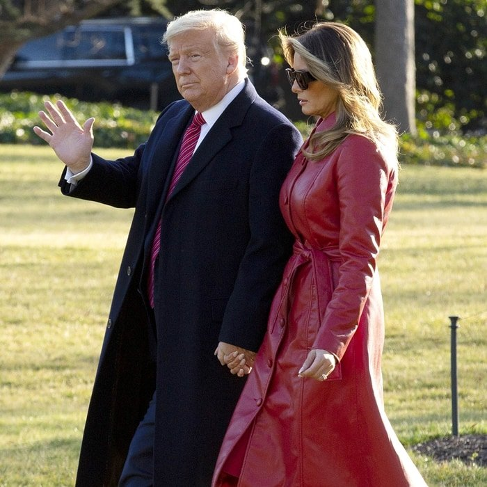 Melania Trump's trench coat is tailored in a timeless silhouette but updated in red faux leather to make it more contemporary