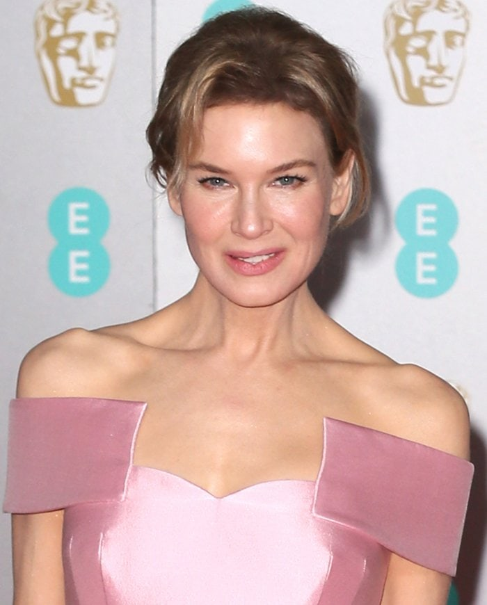 Renee Zellweger looks beautiful with chic updo and soft dewy makeup
