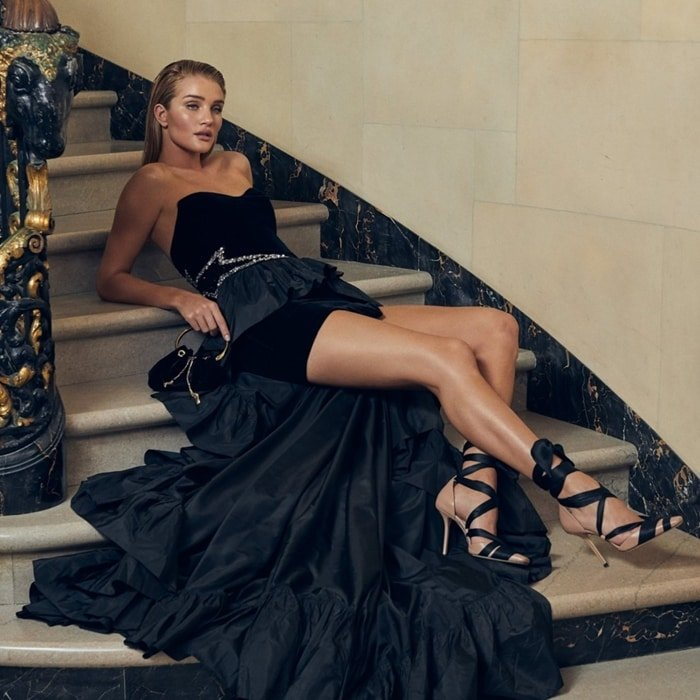 Rosie Huntington-Whiteley wears ballet-pink nappa leather Louren pumps that chime perfectly with the ballet theme for Jimmy Choo's Cruise 2020 Collection