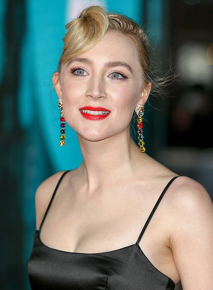 Saoirse Ronan sports a retro updo and a slick of coral red lipstick