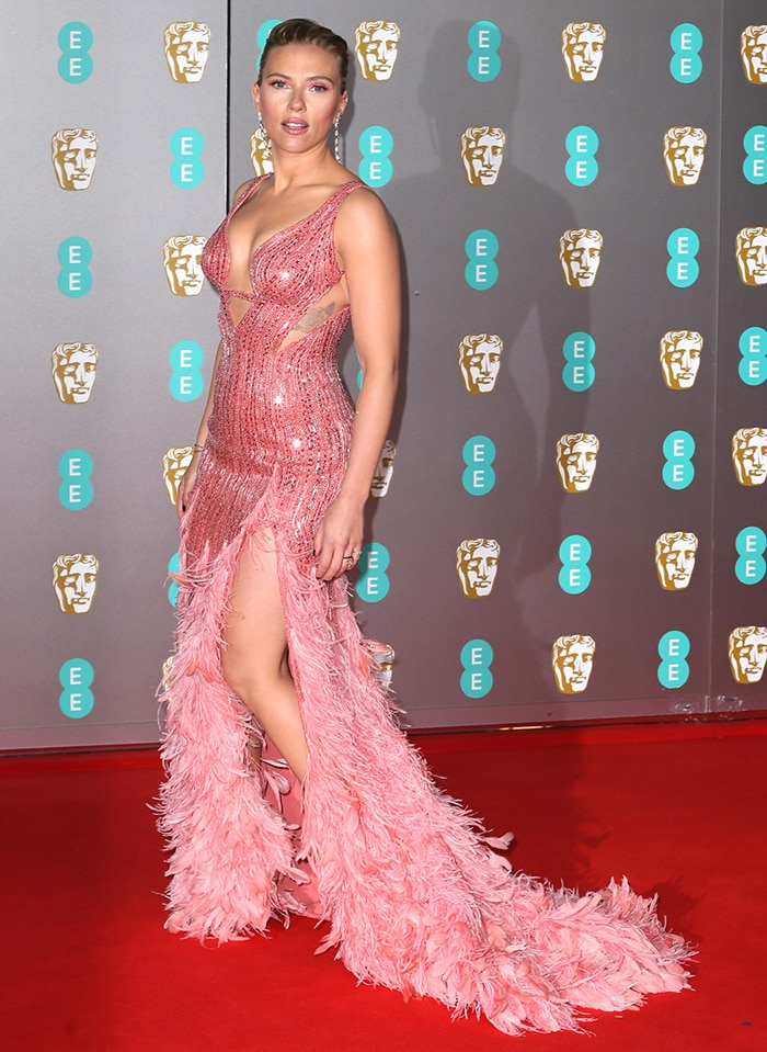 Scarlett Johansson oozes sex appeal in Versace pink embellished, feathered gown