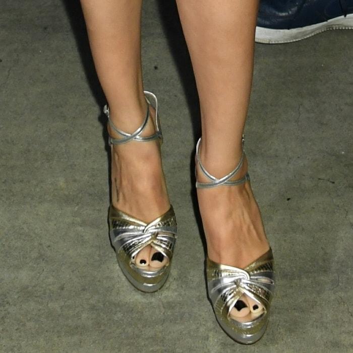 Selena Gomez shows off her pretty feet in gold-tone and silver-tone leather La Di Da platform sandals from Aquazzura