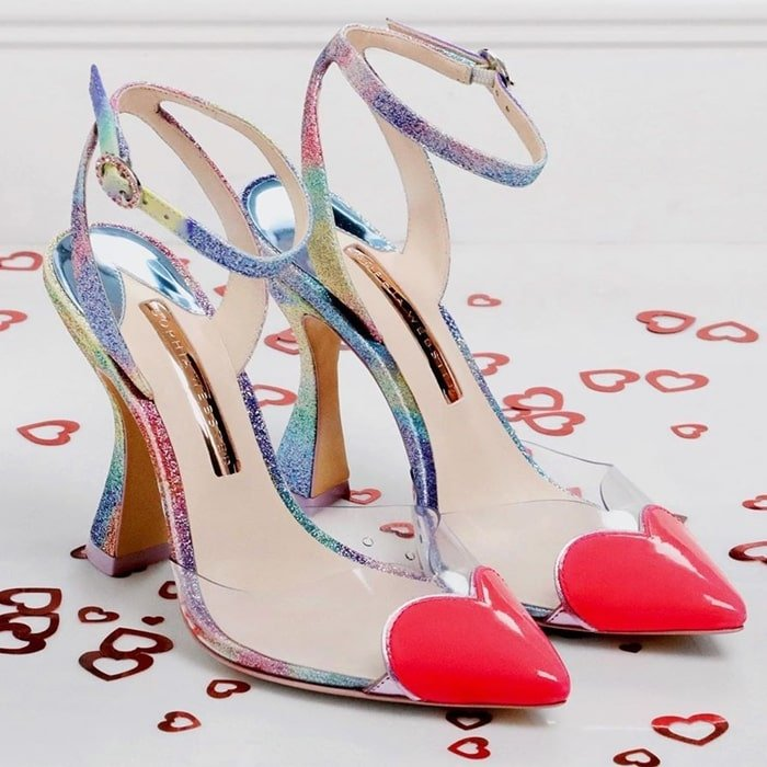 Colorful Amora pumps from Sophia Webster featuring an ankle strap with a side buckle fastening, a heart motif at the toe and a structured high heel