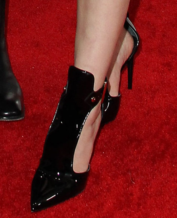 Sophie Turner amps up her edgy look with black patent pointed toe pumps