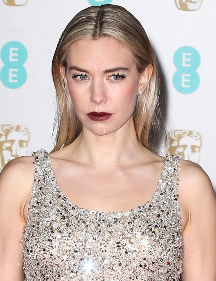 Vanessa Kirby amps up the edge with maroon lipstick and sleek center-parted hairstyle