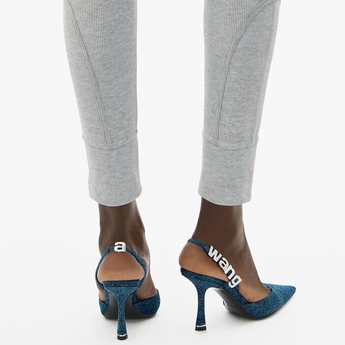 Thee denim pumps have been made in Italy and threaded with silver logo lettering at the slingback straps