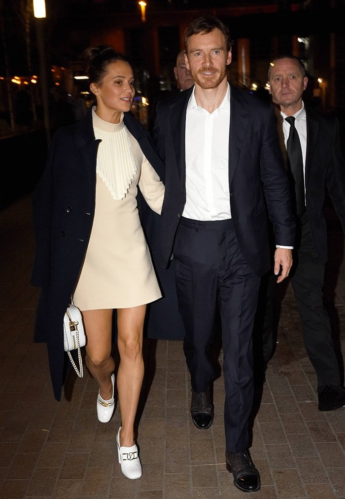 Alicia Vikander stuns in Louis Vuitton while Michael Fassbender looks dapper in a classic suit