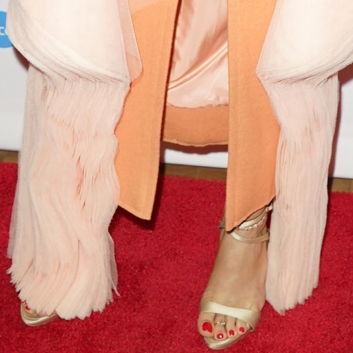 Andra Day shows off her feet in champagne satin Dionne sandals with crystal cut-out from Giuseppe Zanotti