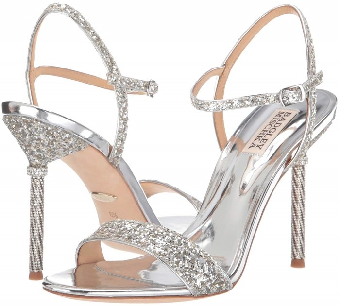 Badgley Mischka Olympia stiletto heel sandals crafted with a textile upper and embellished with sparkly glitter throughout for an eye-catching finish