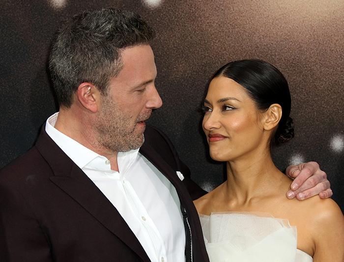 Ben Affleck and Janina Gavankar show off their chemistry at the premiere of their sports drama