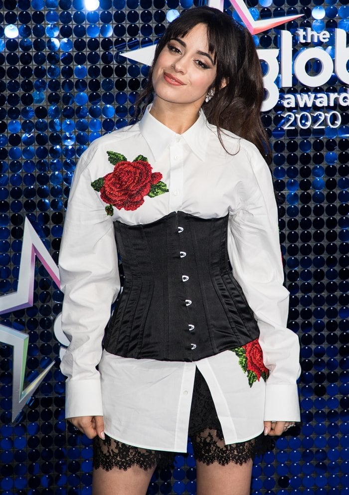Camila Cabello styled an embroidered crepe blouse with a satin corset and sheer chiffon shorts