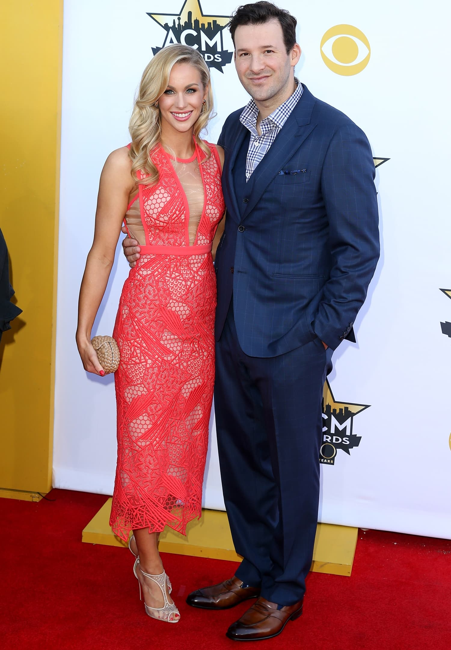 Reporter Candice Crawford (L) and professional football player Tony Romo