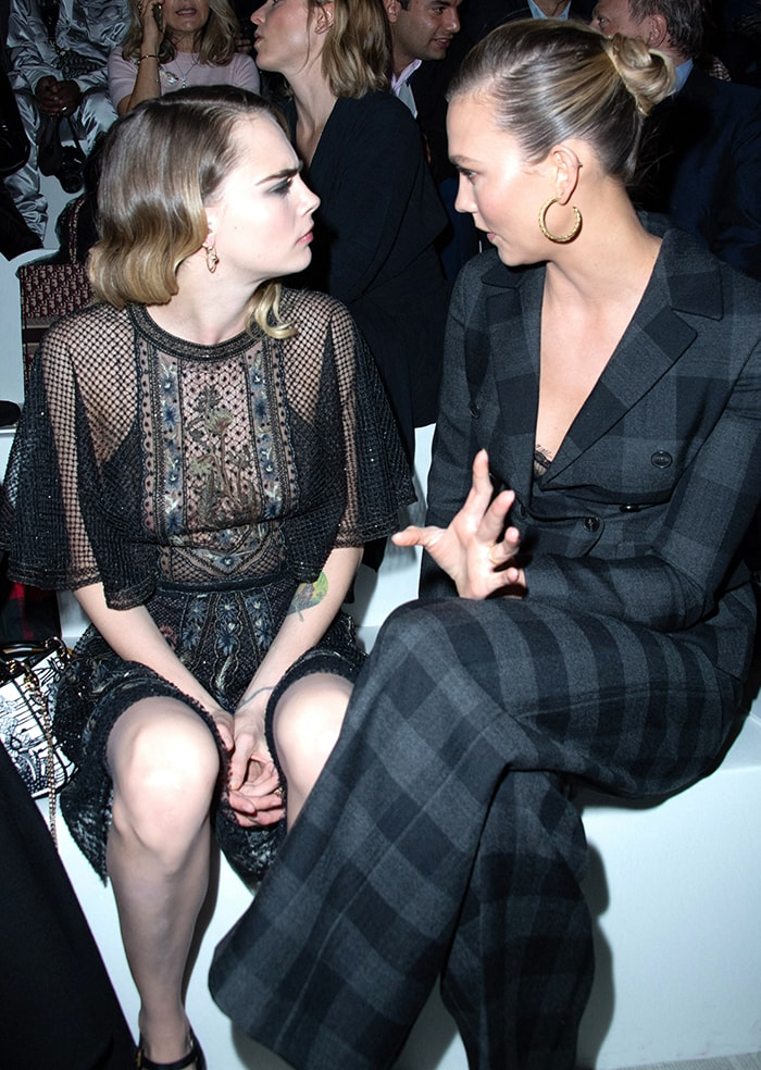 Cara Delevingne sits front row with Karlie Kloss at the Christian Dior Fall/Winter 2020 runway show