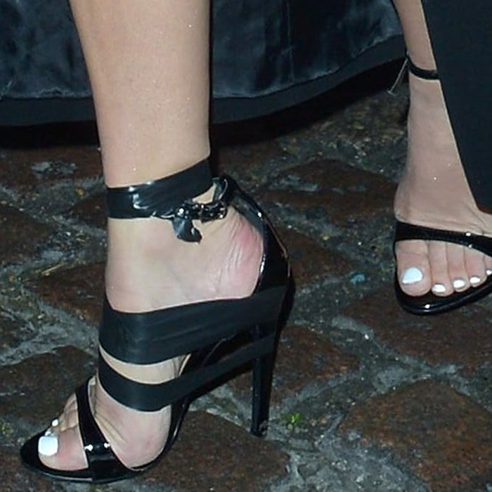 Caroline Flack had to use thick black electrical gaffer tape on her stiletto sandal after her footwear broke