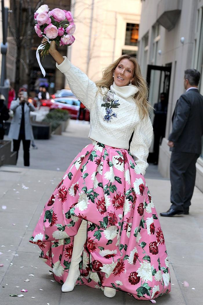 Celine Dion celebrates International Women's Day in Oscar de la Renta pink ball gown and sweater on March 8, 2020