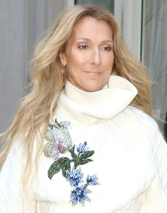 Celine Dion styled her blonde tresses in waves and wears minimal makeup